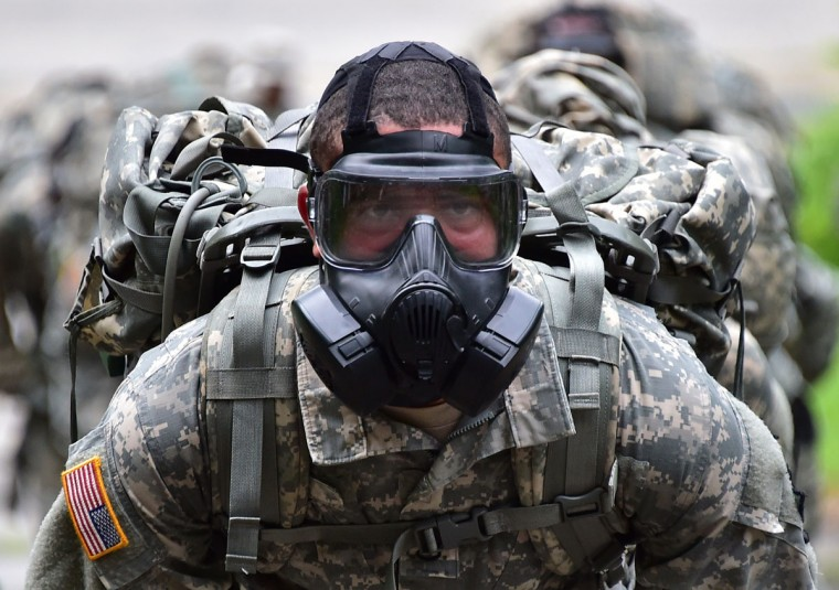 A U.S. soldier wears a gas mask during a competition to test individual skills at a U.S. Army base in Uijeongbu, north of Seoul, on July 8, 2015. The goal of the competition is to foster esprit de corps across the units participating and to continue to strengthen the US-South Korea alliance. (JUNG YEON-JE/AFP/Getty Images)