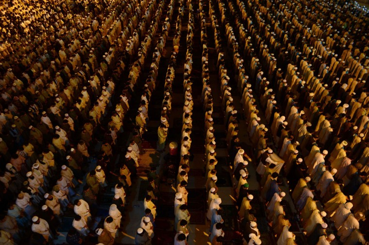"Afghan devotees perform a special evening ""Taraweeh"" prayer during the Islamic holy month of Ramadan at a mosque in Herat province late July 7, 2015. (Aref Karimi/AFP/Getty Images)"
