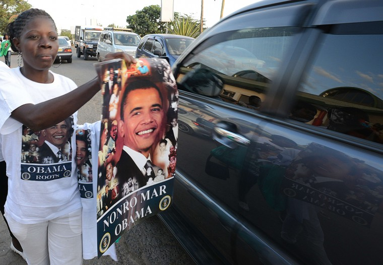 A Kenyan hawker tries to sell a poster with the image of US President Barrack Obama and the words written in the Luo language, 'Nonro Mar Obama' meaning 'Arrangements for Obama visit ' to motorists during the Luo cultural festival, on July 11, 2015, in Nairobi. The Luo festival which is the tribe that Obama's family belongs to, comes weeks ahead of US President Barrack Obama's visit to Kenya. President Obama's visit, is his first visit to his father's homeland since becoming the president of the USA. (Simon Maina/AFP/Getty Images)