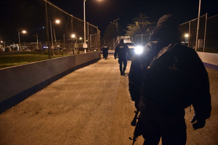 "Federal policemen stand outside of the Altiplano prison in Almoloya de Juarez, Toluca, Mexico, from where Mexican drug trafficker Joaquin Guzman Loera aka ""el Chapo Guzman"" escaped on July 12, 2015. Mexican drug lord Joaquin ""El Chapo"" Guzman has escaped from a maximum-security prison for the second time in 14 years, sparking a massive manhunt and dealing an embarrassing blow to the government. The kingpin was last spotted by security cameras entering the shower area of the Altiplano prison, 90 kilometers (55 miles) west of Mexico City, on July 11 night before disappearing, the National Security Commission said. (Yuri Cortez/AFP/Getty Images)"