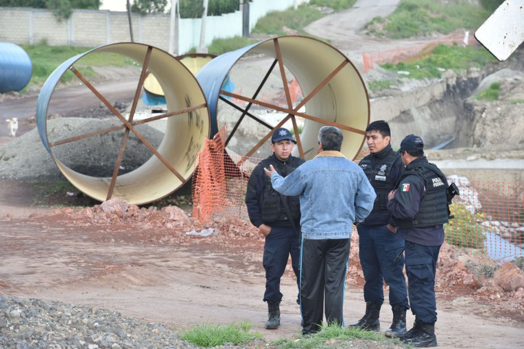 "Policemen search for drug lord Joaquin ""El Chapo"" Guzman in the surroundings of the Altiplano prison in Almoloya de Juarez, Mexico on July 12, 2015. Mexican Guzman has escaped from a maximum-security prison, the government said Sunday, his second jail break in 14 years. The kingpin was last seen in the shower area of the Altiplano prison in central Mexico late Saturday before disappearing. ""The escape of Guzman was confirmed"", the National Security Commission said in a statement. (Yuri Cortez/AFP/Getty Images)"