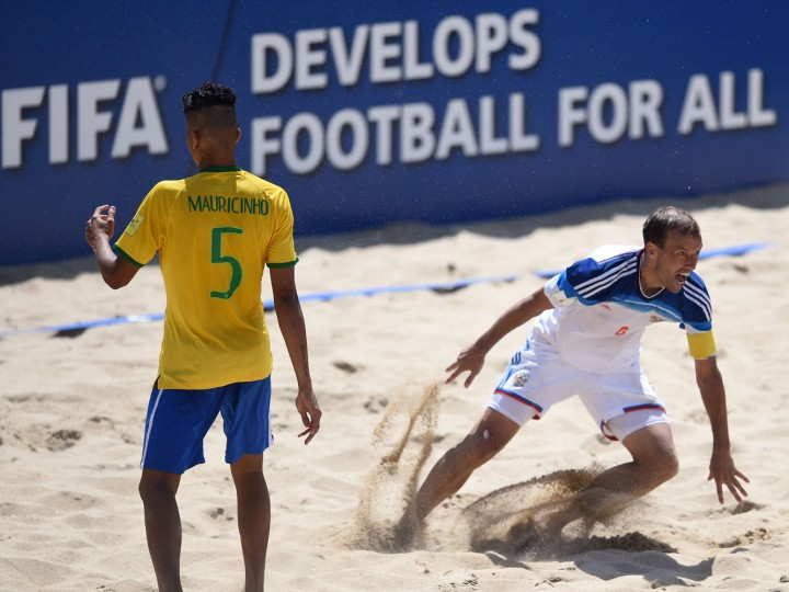 Russia's pivot Egor Shaikov (R) celebrates after scoring a goal on overtime during the FIFA Beach Soccer World Cup football match Brazil vs Russia in Espinho on July 16, 2015. Russia won and is qualified for semi-finals. (Francisco Leong/AFP/Getty Images)