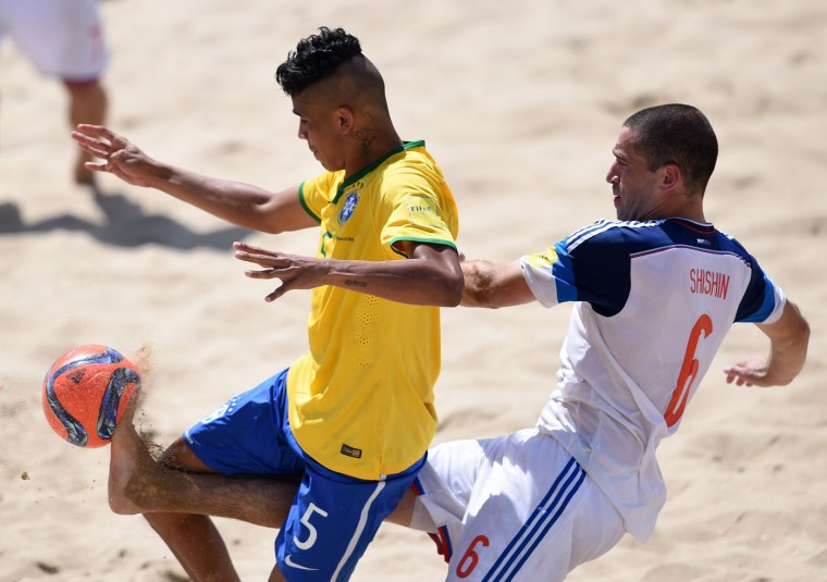 Brazil's pivot Mauricinho (L) vies with Russia's wing Dmitrii Shishin during the FIFA Beach Soccer World Cup 2015 football match Brazil vs Russia in Espinho on July 16, 2015. (Francisco Leong/AFP/Getty Images)