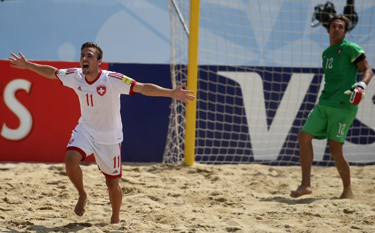 Switzerland's pivot Noel Ott (L) celebrates after scoring a goal during the FIFA Beach Soccer World Cup football match Portugal vs Switzerland in Espinho on July 16, 2015. (Francisco Leong/AFP/Getty Images)