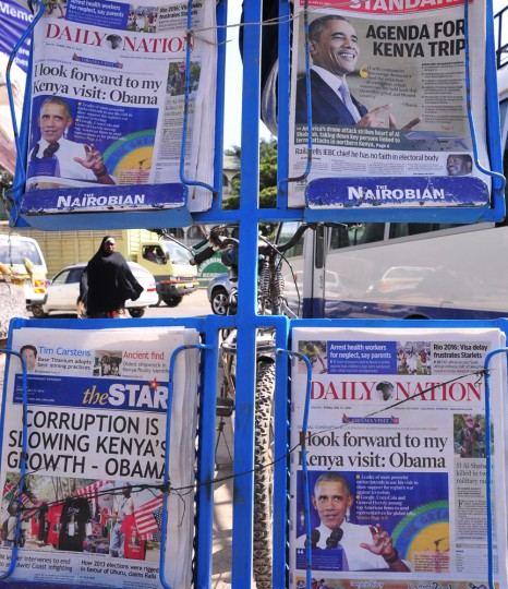 A woman walks next to local newspapers bearing headlines on US President Barack Obama's upcoming visit to Kenya on July 17, 2015 in Nairobi. Obama is due to visit Ethiopia later this month as well as Kenya, where his father was born. (Simon Maina/AFP/Getty Images)