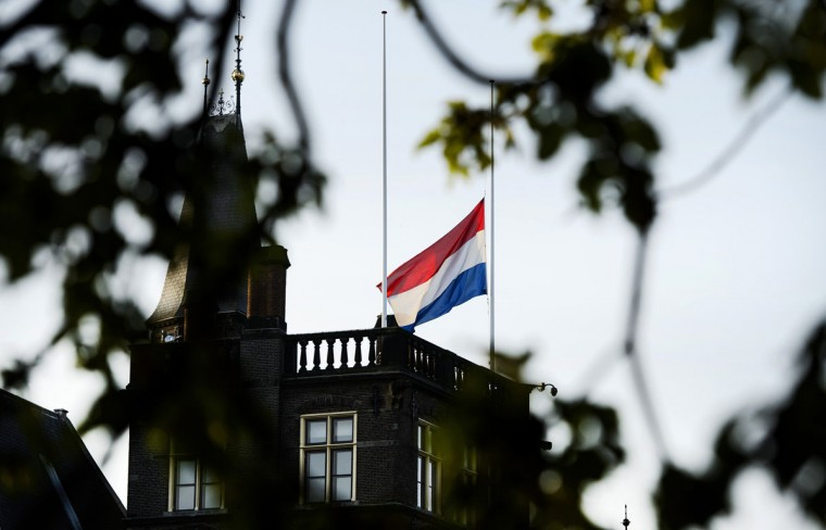 The Dutch flag flies at half mast above the first chamber in The Hague, on July 17, 2015. Britain joined a chorus of countries calling for a UN-backed tribunal to prosecute those responsible for downing flight MH17, as relatives remembered their dead in ceremonies on the first anniversary of the disaster. All 298 passengers and crew -- the majority Dutch -- died on July 17 last year when the Malaysia Airlines Boeing 777, on a flight between Amsterdam and Kuala Lumpur, was shot down over rebel-held east Ukraine during heavy fighting between Ukrainian forces and pro-Russian separatists. (AFP Photo/Anp / )