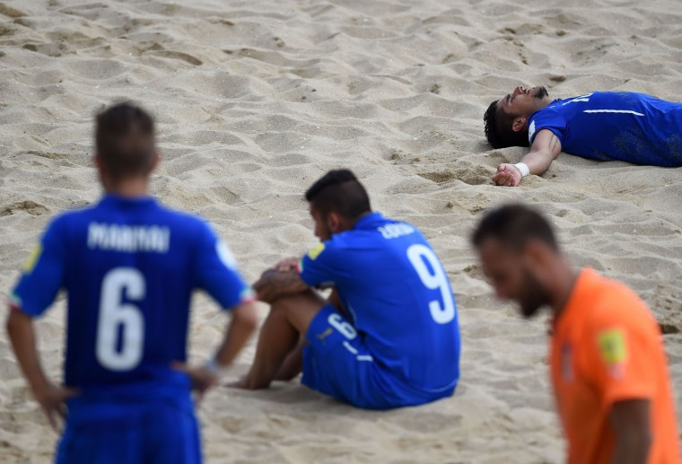 Italy's players react at the end of the FIFA Beach Soccer World Cup football match Italy vs Tahiti in Espinho on July 18, 2015. Tahiti won and qualified for final. (Francisco Leong/AFP/Getty Images)