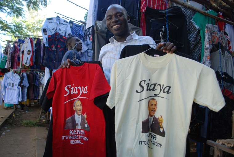 Kenyan clothing vendor Hosea Owuor sets out a display of T-shirts featuring an image of American president Barrack Obama at his stall in Kisumu on July 8, 2015 ahead of Obama's visit to Kenya. Obama will be embarking upon his fourth visit to Africa since becoming US president, but his first to Kenya since taking office in 2009. (Denish Ochiengi/AFP/Getty Images)