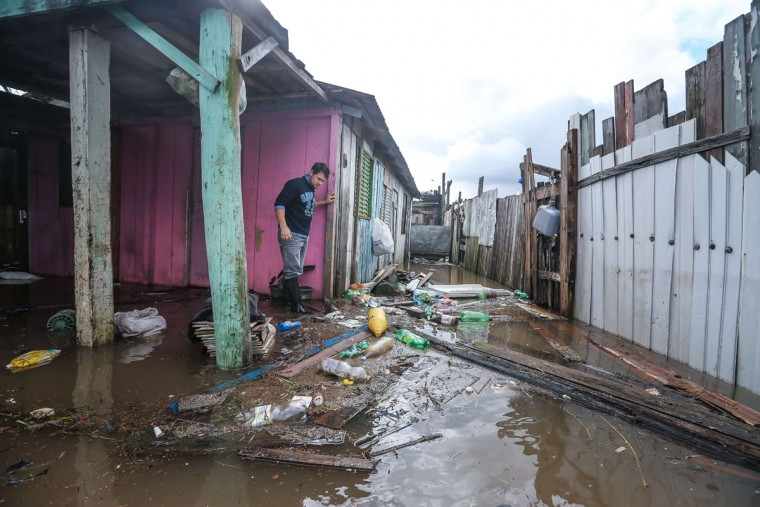 A local resident at his flooded home in Villa Rica, Gravatai, Brazil, on July 21, 2015. (JEFFERSON BERNARDES/AFP/Getty Images)