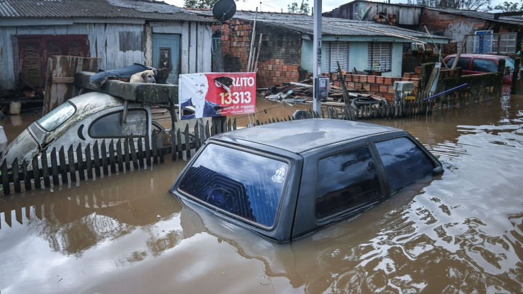 A flooded street in Villa Rica, Gravatai, Brazil, on July 21, 2015. (JEFFERSON BERNARDES/AFP/Getty Images)