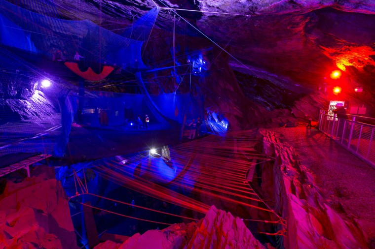 'Bounce Below' is a network of giant trampolines, walkways and slides suspended in the caverns of the 176-year old disused Llechwedd slate mine near Blaenau Ffestiniog, North Wales. Picture taken on July 21, 2015. (OLI SCARFF/AFP/Getty Images)