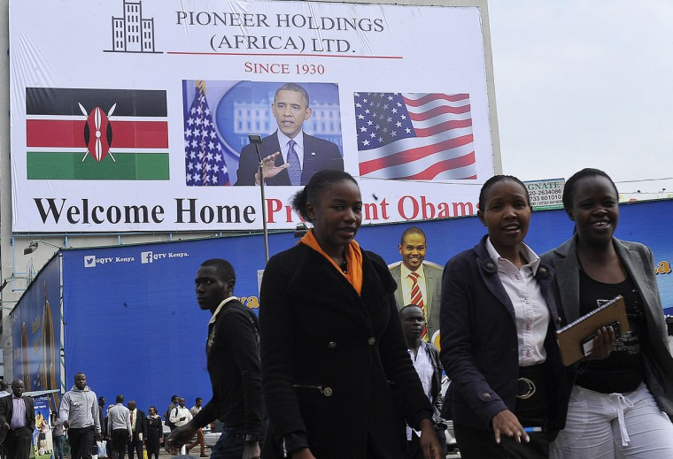 People walk past a billboard welcoming US President Barack Obama on July 22, 2015 in Nairobi, ahead of his visit. Obama will make his first presidential pilgrimage to his father's homeland of Kenya later this month, the cap to his week-long trip to three key African nations. (Simon Maina/AFP/Getty Images)