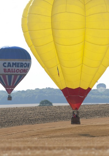 "Hot-air balloons are seen near Chambley-Bussieres airbase, eastern France, on July 26, 2015, on the first day of the international air-balloon meeting ""Lorraine Mondial Air Balloons"". (JEAN-CHRISTOPHE VERHAEGEN/AFP/Getty Images)"