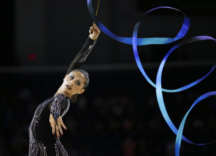 Mexico's Karla Diaz performs during the during the rhythmic gymnastics ribbon competition in the Pan Am Games in Toronto Monday, July 20, 2015. (AP Photo/Gregory Bull)