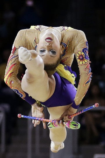 Canada's Carmen Whelan performs during the rhythmic gymnastics clubs competition in the Pan Am Games in Toronto Monday, July 20, 2015. (AP Photo/Gregory Bull)