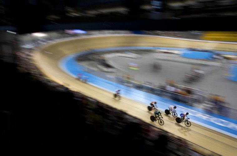 Athletes compete during the men's omnium scratch track cycling event at the Pan Am Games in Milton, Ontario, Thursday, July 16, 2015. (AP Photo/Felipe Dana)