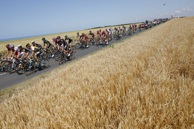 The pack rides along the English Channel on France's Normandy west coast during the sixth stage of the Tour de France cycling race over 191.5 kilometers (119 miles) with start in Abbeville and finish in Le Havre, France, Thursday, July 9, 2015. (AP Photo/Laurent Cipriani)