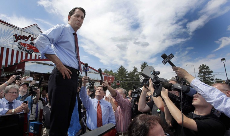 Republican presidential candidate, Wisconsin Gov. Scott Walker, R-Wis., speaks to an overflow crowd from the back of a pickup truck outside Joey's Diner, Thursday, July 16, 2015, in Amherst, N.H. (AP Photo/Jim Cole)