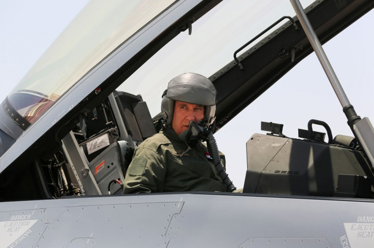 Iraqi defense Minister Khaled al-Obeidi prepares to test one of four new U.S.- made F-16 fighter jets during the delivery ceremony at Balad air base, 75 kilometers (45 miles) north of Baghdad, Iraq, Monday, July 20, 2015. (AP Photo/Khalid Mohammed)