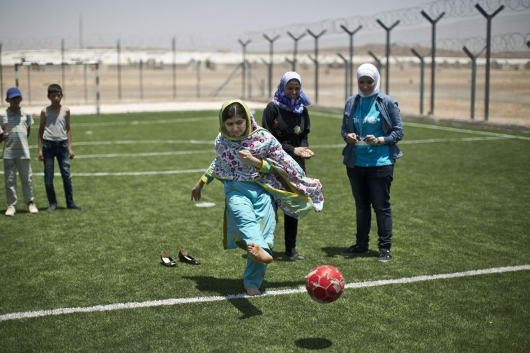 "Nobel Peace Prize recipient Malala Yousafzai, 18, kicks the ball while playing soccer with Syrian refugee children during her visit to Azraq refugee camp in Jordan, Monday, July 13, 2015. Rich countries should spend less on weapons in the Syria conflict and more on education, Nobel Peace Prize winner Malala Yousafzai said Monday, calling world leaders ""quite stingy"" as she visited a camp for Syrian war refugees. (AP Photo/Muhammed Muheisen)"