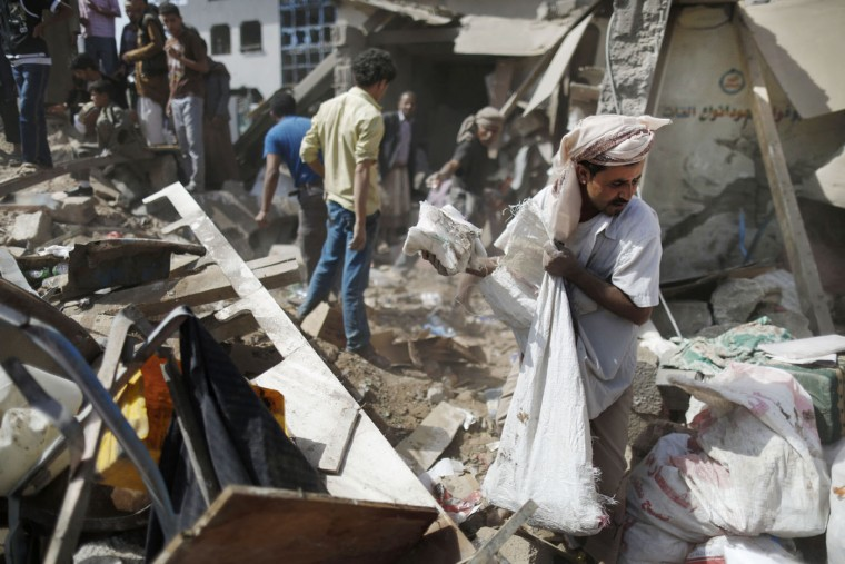 "A vendor salvages goods from the rubble of his shop destroyed by a Saudi-led airstrike at a market in Sanaa, Yemen, Monday, July 20, 2015. The death toll in Yemen from the Shiite rebel shelling of a town near the southern port city of Aden rose on Monday to nearly 100, the head of an international aid group said, describing it as ""the worst day"" for the city and its surroundings in over three months of fighting. (AP Photo/Hani Mohammed)"