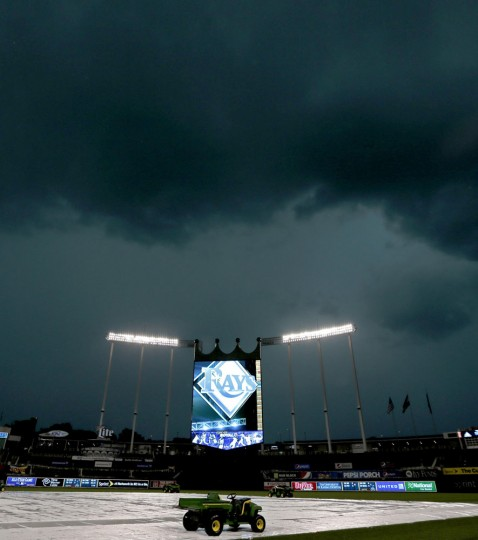Dark clouds hang over Kauffman Stadium as as severe thunderstorm passes though before a baseball game between the Kansas City Royals and the Tampa Bay Rays Monday, July 6, 2015, in Kansas City, Mo. The game was postponed and will be replayed Tuesday as the first game of a doubleheader. (AP Photo/Charlie Riedel)
