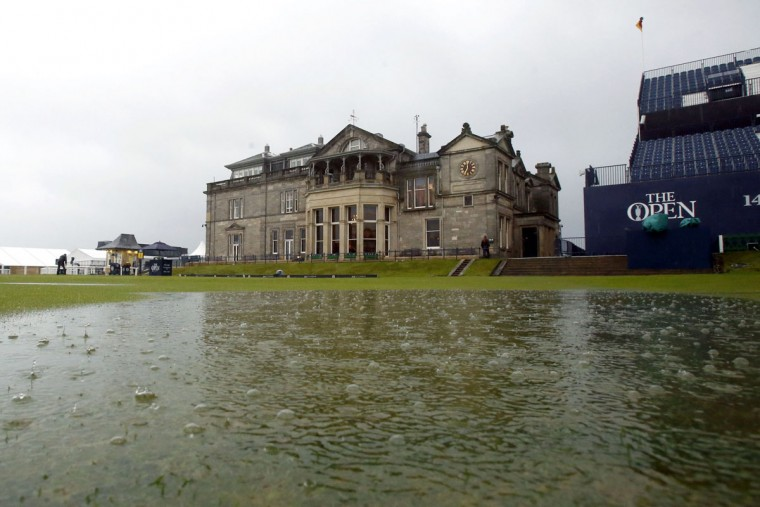 Deep puddles form on the 18th hole as heavy rain suspends play during day two of The British Open Championship 2015 at St Andrews in Fife Friday, July 17, 2015. (Danny Lawson/PA via AP)