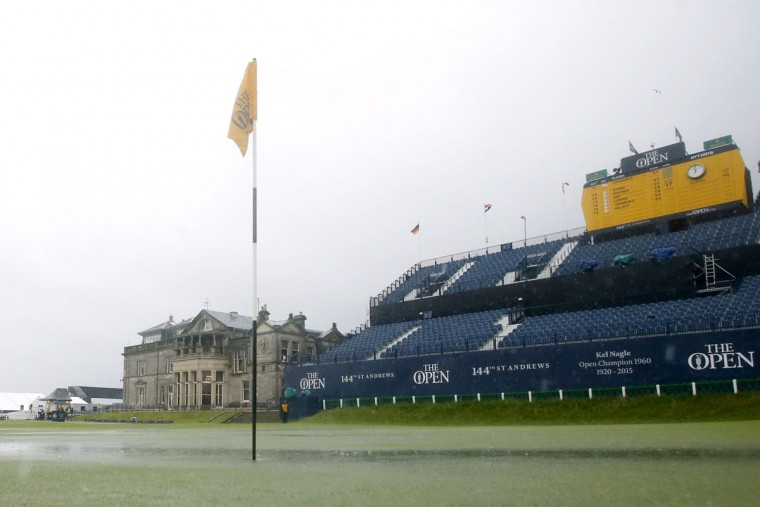 Deep puddles form on the 18th hole as heavy rain suspends play during day two of The British Open Championship 2015 at St Andrews in Fife Friday July 17, 2015. (Danny Lawson/PA via AP)