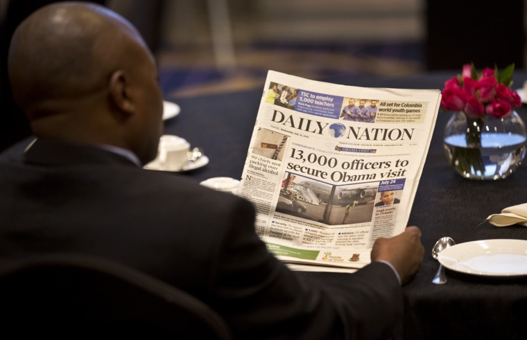 A man attending an investor's breakfast meeting with the Mama Sarah Obama Foundation charitable organization, named after President Barack Obama's step-grandmother Sarah Obama, reads a copy of the Kenyan Daily Nation newspaper whose front page highlights the security measures being put in place ahead of the President's visit to the country later in the month, in Nairobi, Kenya Wednesday, July 15, 2015. President Barack Obama is due to make his first trip as president to Kenya, the country of his father's birth, to attend the Global Entrepreneurship Summit, which brings together business leaders, international organizations and governments. (AP Photo/Ben Curtis)
