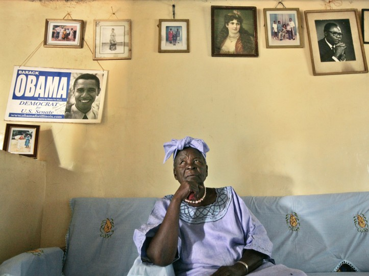 FILE - In this Thursday, Feb. 5, 2008 file photo, Sarah Obama, step-grandmother of President Barack Obama, sits in the living room of her house in the village of Kogelo, near the shores of Lake Victoria, in Kenya. On Friday, July 24, 2015 Obama is due to arrive in Kenya, the country of his father's birth, for the first time since he was a U.S. senator in 2006, and the first stop on his two-nation African tour in which he will also visit Ethiopia. (AP Photo/Ben Curtis, File)