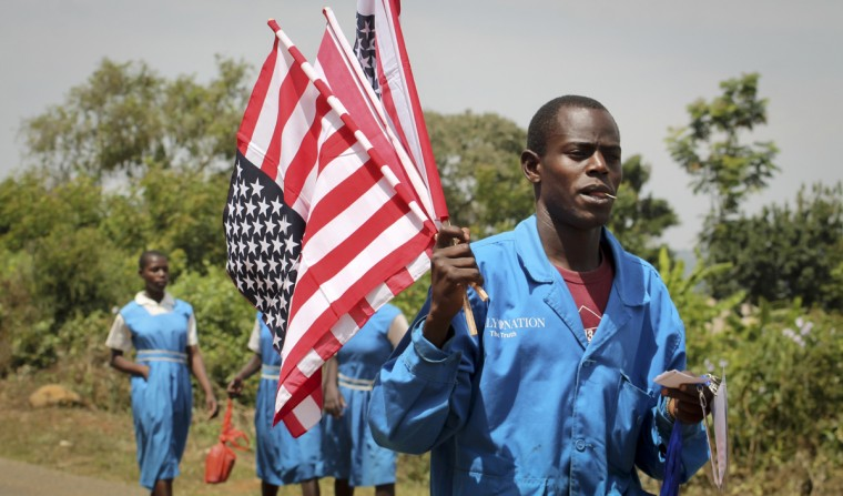 A vendor sells American flags at an event attended by Sarah Obama, the step-grandmother of President Barack Obama, in her home town of Kogelo, near Kisumu, in Kenya Saturday, July 18, 2015. President Barack Obama is due to make his first trip as president to Kenya later in the month, the country of his father's birth, to attend the Global Entrepreneurship Summit, which brings together business leaders, international organizations and governments. (AP Photo)