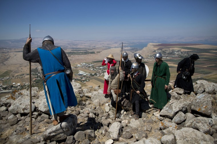 In this Saturday, July 4, 2015 photo, Israeli and Russian members of knight clubs get ready for the reenactment of the Battle of Hattin in Horns of Hattin, northern Israel. About a third of the participants arrived with their elaborate gear from Russia. The project is supported by the Lower Galilee Regional Council. (AP Photo/Oded Balilty)