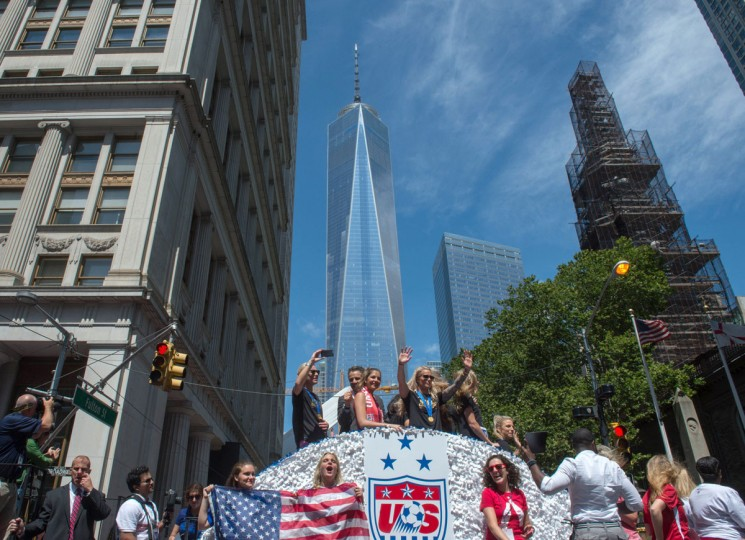 U.S. women's soccer team members are joined by New York Gov. Andrew Cuomo, second from left, as their float makes its way up Broadway's Canyon of Heroes during the ticker tape parade to celebrate the team's World Cup victory, Friday, July 10, 2015, in New York. (AP Photo/Bryan R, Smith)