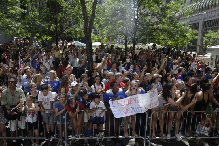 U.S. women's soccer team fans cheer as the players make their way up Broadway's Canyon of Heroes during the ticker-tape parade to celebrate their World Cup victory, Friday, July 10, 2015, in New York. (AP Photo/Mary Altaffer)