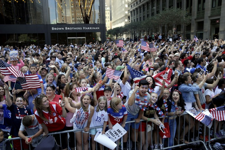 U.S. women's soccer team fans cheer as the players make their way up Broadway's Canyon of Heroes during the ticker tape parade to celebrate their World Cup victory, Friday, July 10, 2015, in New York. (AP Photo/Mary Altaffer)