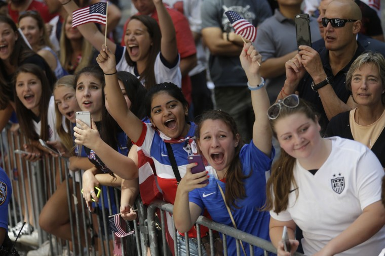 U.S. women's soccer team fans cheer as the players make their way up Broadway's Canyon of Heroes during the ticker tape parade to celebrate the U.S. women's soccer team World Cup victory, Friday, July 10, 2015, in New York. (AP Photo/Mary Altaffer)