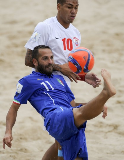 Italy's Palmacci, front, vies Tahiti's Labaste during their FIFA Beach Soccer World Cup semi-final match in Espinho, Portugal, Saturday, July 18, 2015. Tahiti win on penalties 3-1 after a 6-6 draw. (AP Photo/Paulo Duarte)