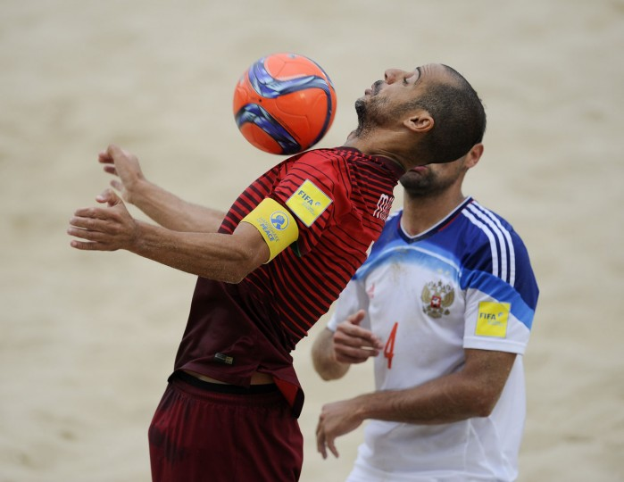 Portugal's Madjer, left, controls the ball next to Russia's Makarov during their FIFA Beach Soccer World Cup semi-final match in Espinho, Portugal, Saturday, July 18, 2015. Portugal won 4-2. (AP Photo/Paulo Duarte)