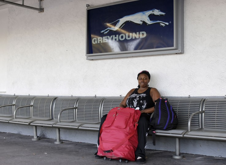 In this photo taken June 18, 2015, Ro Brown, 23, poses for a photograph as he waits in a Greyhound bus station in Miami, with his wife, not pictured, for a bus to Macon, Ga. Brown, who identifies as a transgender male, has been homeless for six years, and has not yet told his family about his gender identity. He is moving to Georgia to live with his wife's family, where they hope to find work and move into their own place. (AP Photo/Lynne Sladky)