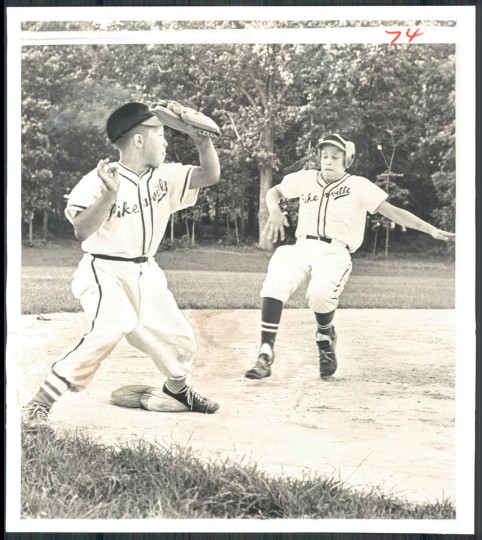 Sticking his tongue out at runner Brien Pierpont is Pikesville third sackers Billy Waldon, who went on to tag out Brien in game at Sudbrook Junior High. (William L. La Force, Jr/Baltimore Sun, 1968)