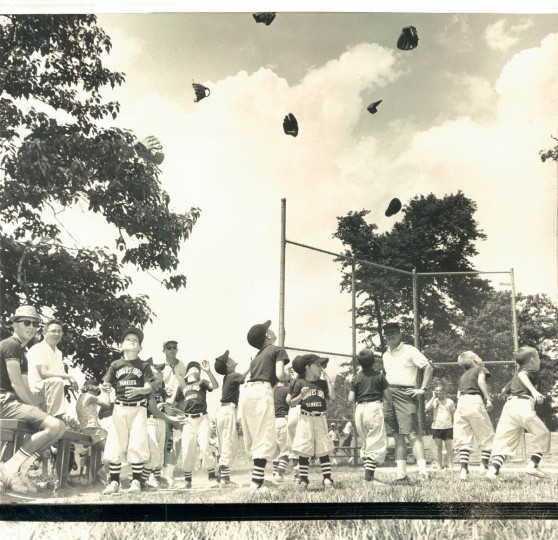 RAINING CAPS AND TOGS - Rodgers Forge Yanks heave their paraphernalia heavenward after defeating the Indians, clinching first place in Towson farm loop's Southern division. (William H. Mortimer/Baltimore Sun, 1964)