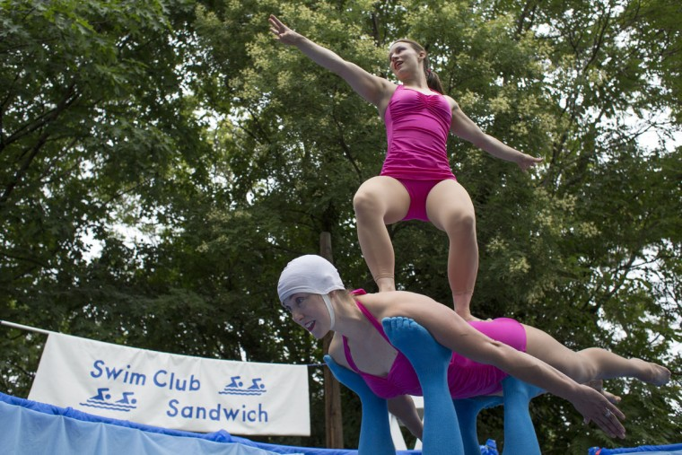 Amy Longeriver stands on Kelly Marburger during a performance by the Swim Club Sandwich at Artscape. (Tom Brenner/The Baltimore Sun)