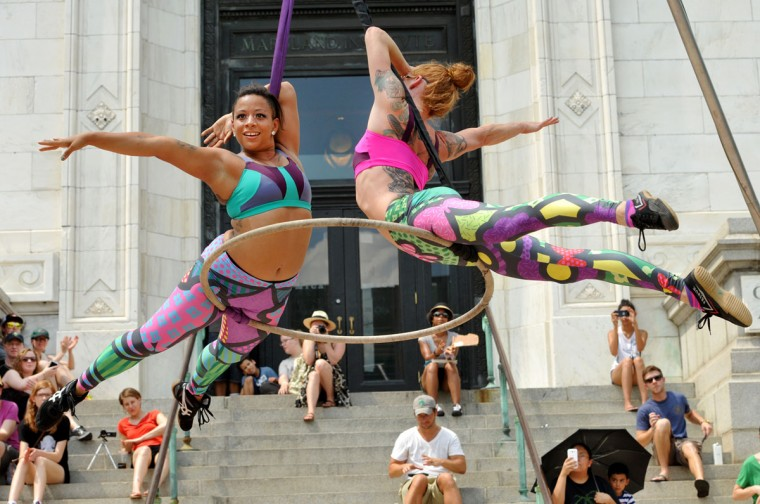 "Aerial dancers Nina Charity, left, and Kelly Jo Stoull, right, perform ""Pop-Art in Action"" at Artscape. (Amy Davis/Baltimore Sun)"