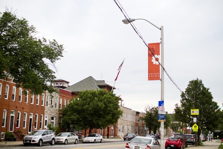 A banner showcasing the neighborhood as 'Locust Point' overlooks Fort Avenue. (Kalani Gordon, Baltimore Sun, June 2015)