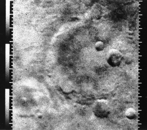 July 14, 1965: Fifty years to the day before New Horizons reached Pluto, the Mariner 4 spacecraft took the first-ever picture of another planet when it captured a shot of Mars. (NASA Photo)
