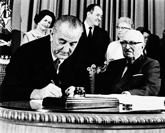 July 30, 1965: President Lyndon B. Johnson signs into law the Social Security Act, which establishes Medicare and Medicaid. (AP File photo)