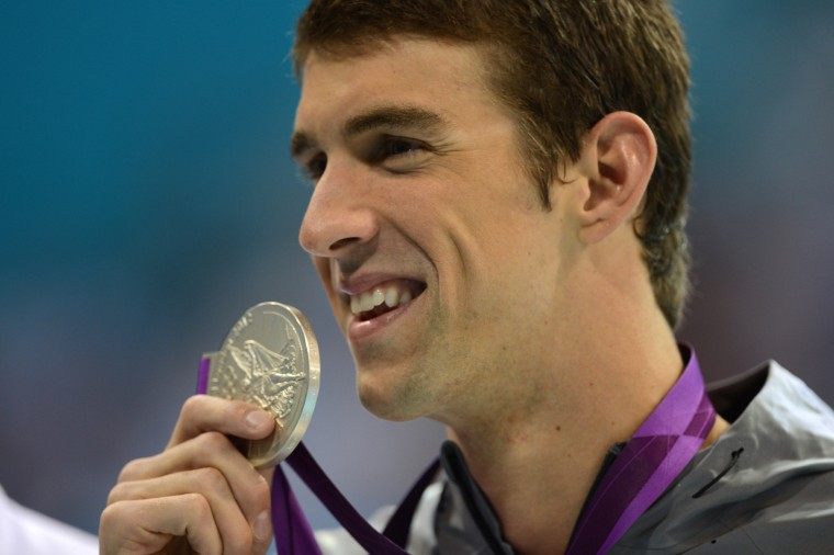Aug. 1, 2012: Michael Phelps becomes to most decorated Olympian in history at the 2012 Summer Olympic Games in London. (AFP PHOTO / CHRISTOPHE SIMONCHRISTOPHE SIMON/AFP/GettyImages)