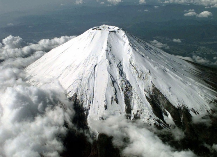 July 31, 781: The oldest recorded eruption of Japan's Mount Fuji, seen here in 1999, took place on this date. (AP Photo/Kyodo)