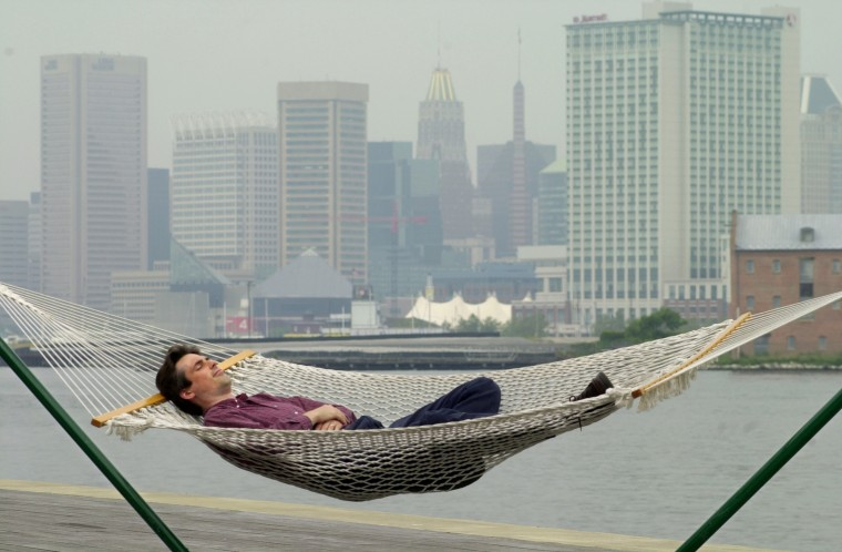 Aug. 13, 2003: Businessman Paul LaPorte of Baltimore took a brief lunchtime break on a hammock on the waterfront deck at the Tidepoint complex in Locust Point, after a morning business meeting at Tidepoint. (Kalani Gordon, Baltimore Sun, June 2015)
