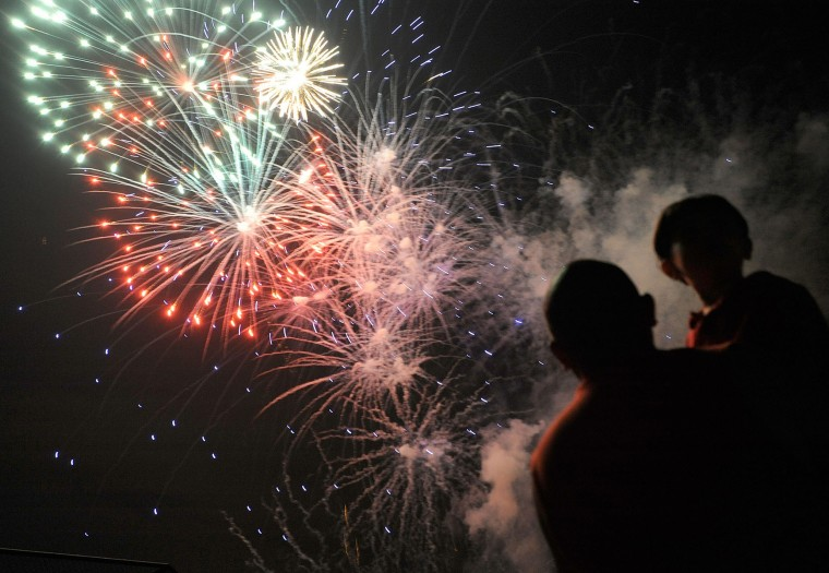 Fireworks in Towson, July 5. Photo taken with Nikon D700. The f-stop was set at f/2.8, the ISO at 2500 and the focal length at 35mm. The exposure time was 1/20th of a second. (Steve Ruark/For The Baltimore Sun)